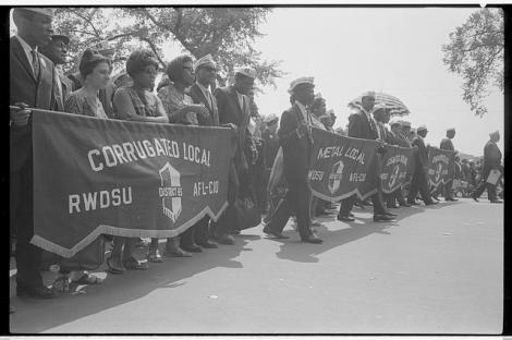 "Marchers carrying labor union banners, including one reading ""Corrugated Local RWDSU District 65, AFL-CIO"" during the March on Washington, 1963 (Library of Congress)"