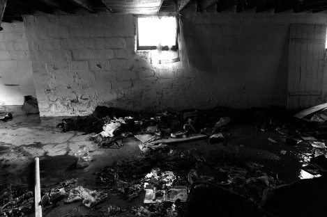 The flooded basement of an abandoned home on McClellan St. in Detroit, Michigan's east side on Wedesday, July 15, 2009.  (blakeryanlewis©2009)